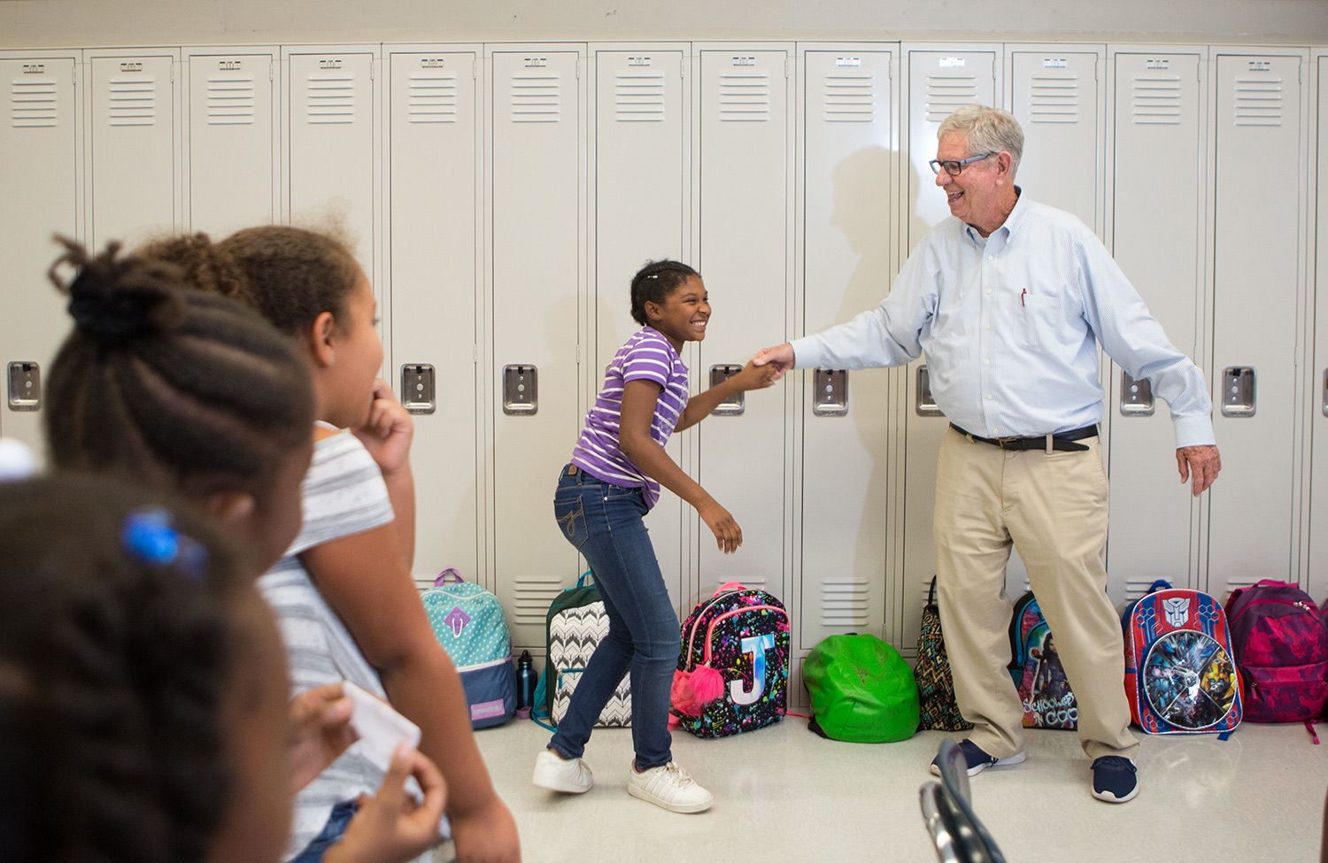 Bob Kronick dancing with students during a music lesson.
